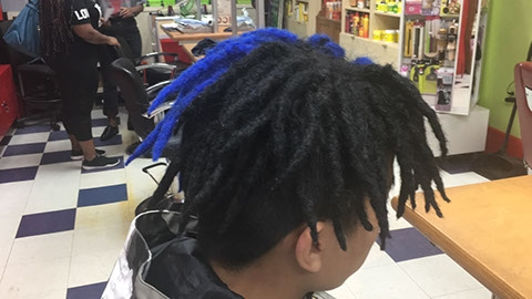 Dreadlocks on boy with black and blue hair